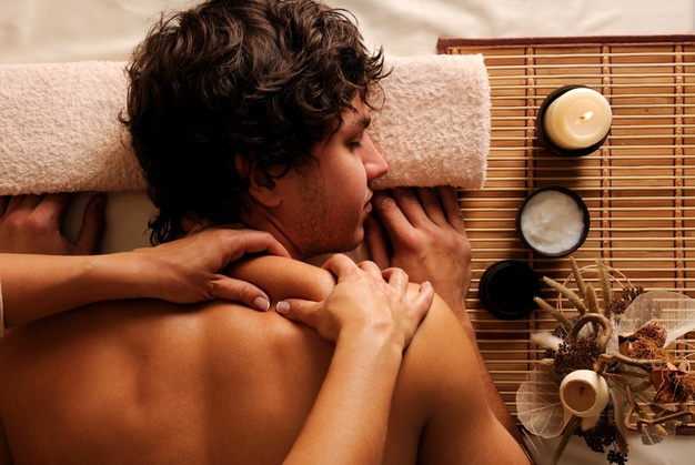 young-man-spa-treatment-recreation-rest-relaxation-massage-hygh-angle-view_186202-4242